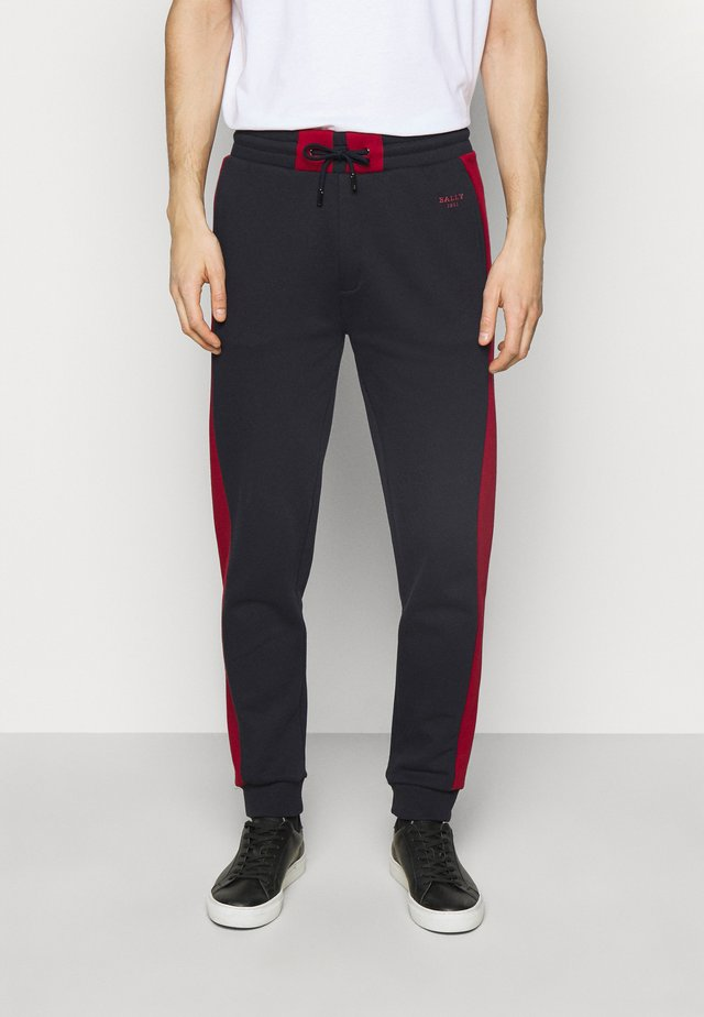 Trainingsbroek - ink/bally red