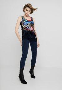 Diesel - SLANDY ZIP - Jeans Skinny Fit - indigo - 1