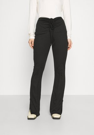 RUCHED FRONT - Leggings - Trousers - black
