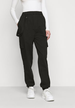 RING STRAP PANT - Trousers - black
