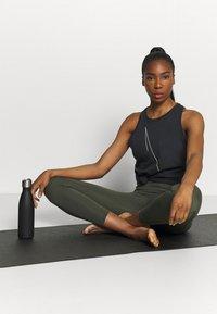 Nike Performance - DRY TANK  YOGA - Sports shirt - black - 1