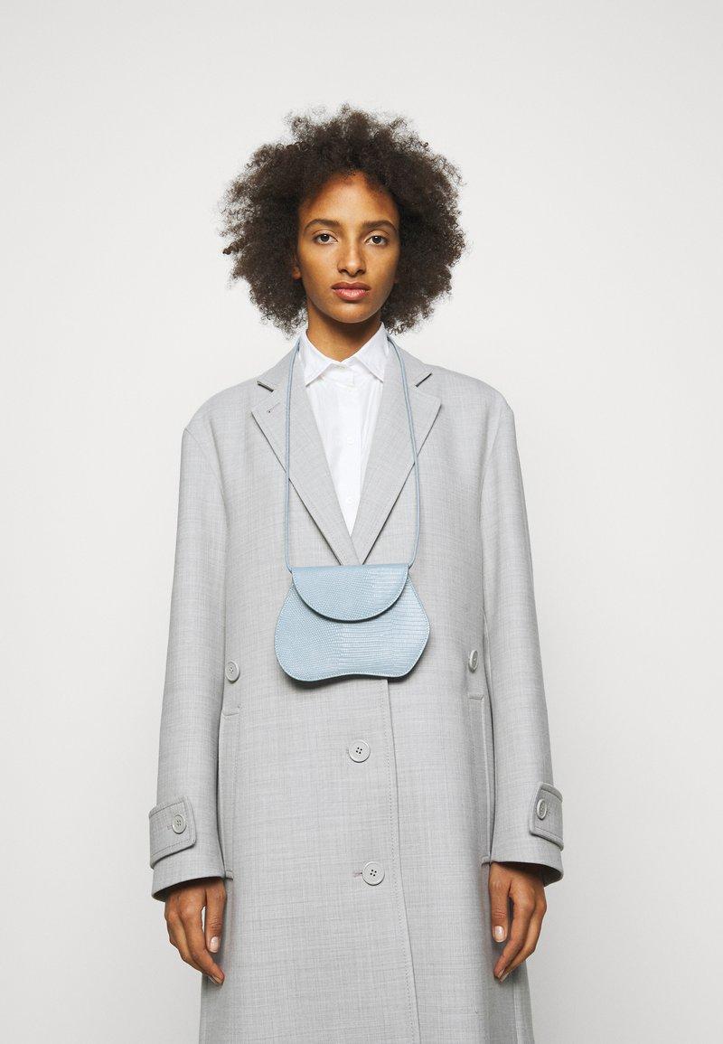 Little Liffner - PEBBLE MICRO BAG - Across body bag - light blue
