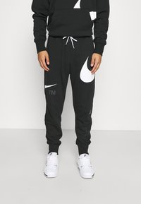 Nike Sportswear - PANT - Trainingsbroek - black/white - 1
