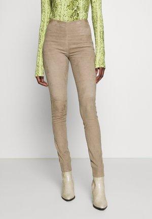ASTEROID - Kožené kalhoty - beige
