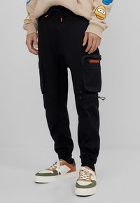 Bershka - Cargo trousers - black - 0