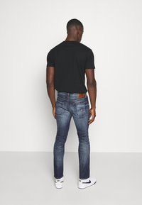 Tommy Jeans - SCANTON SLIM - Slim fit -farkut - clint three years comfort - 2
