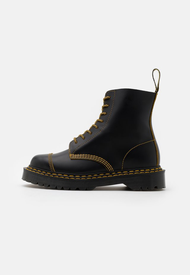 1460 PASCAL UNISEX  - Lace-up ankle boots - black/yellow