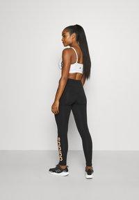 adidas Performance - LOUNGEWEAR ESSENTIALS HIGH-WAISTED LOGO LEGGINGS - Tights - black/ambient blush - 2