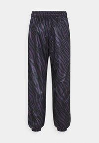 Nike Sportswear - Tracksuit bottoms - dark raisin/bright mango - 7