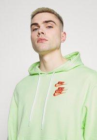 Nike Sportswear - HOODIE - Luvtröja - liquid lime - 4