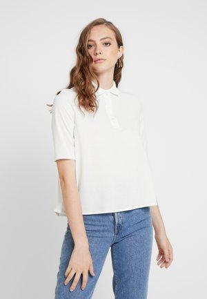 FEMME - Polo shirt - farine