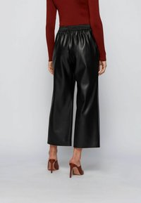 BOSS - TAOMIE - Leather trousers - black - 2
