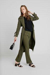 KIOMI - Trousers - olive - 1
