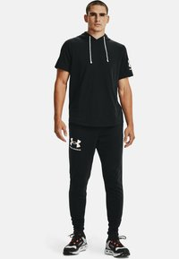 Under Armour - RIVAL TERRY  - Tracksuit bottoms - black - 1