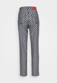 Fiorucci - CHECKERBOARD - Straight leg jeans - light vintage - 1