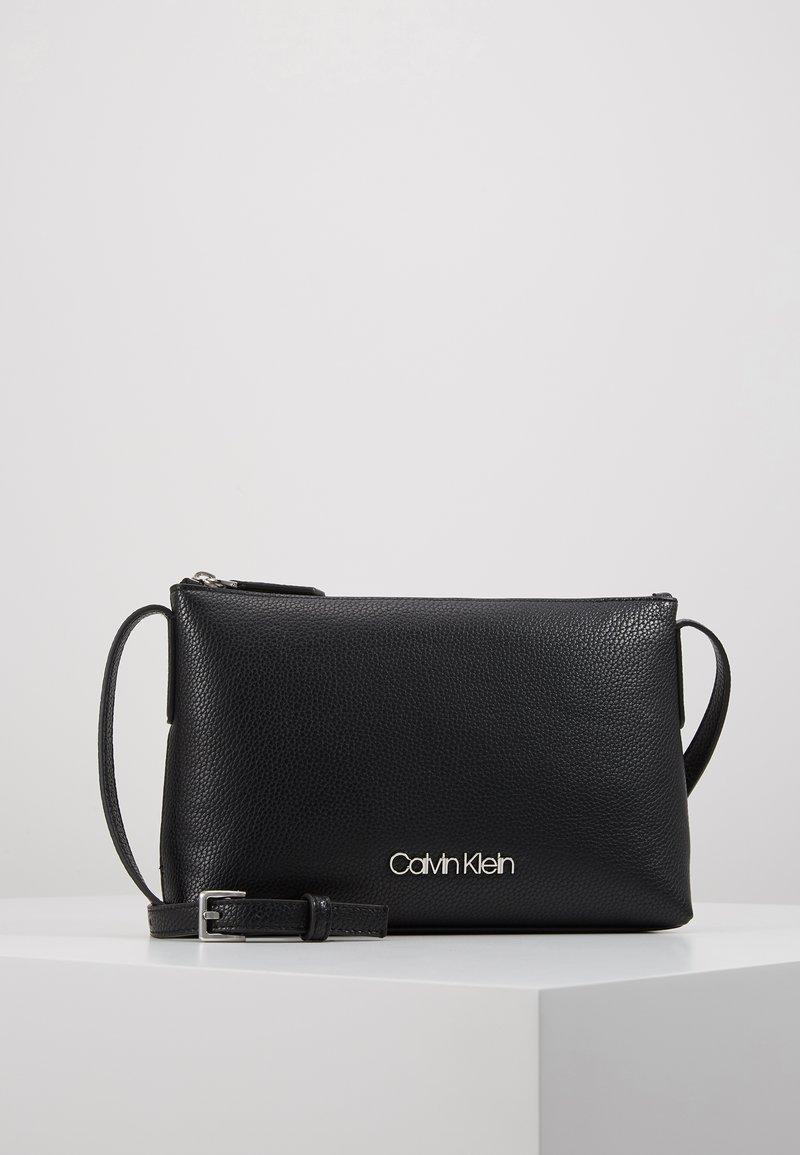 Calvin Klein - NEAT CROSSBODY - Across body bag - black