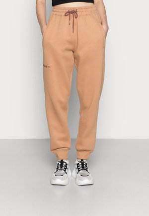 LOOPBACK JOGGERS - Tracksuit bottoms - camel