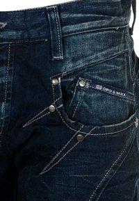 Cipo & Baxx - MIT ZIERNÄHTEN UND REISSVERSCHLÜSSEN - Straight leg jeans - donkerblauw - 4