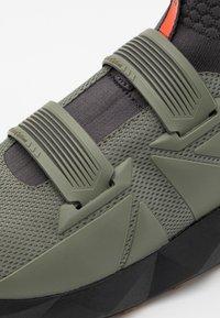 Columbia - FACET45 OUTDRY - Hiking shoes - stone green/autumn orange - 5