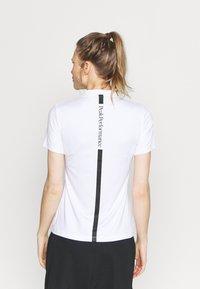 Peak Performance - TURF ZIP - Print T-shirt - white - 2