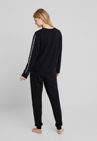 Calvin Klein Underwear - 1981 BOLD LOUNGE JOGGER - Pyjamasbukse - black - 2