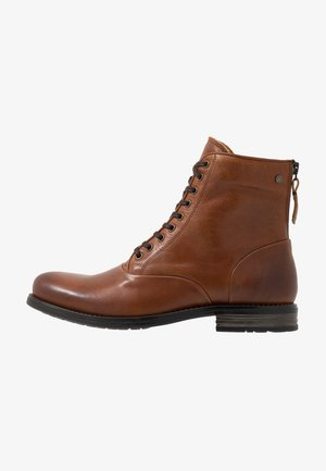 DELERIUS - Lace-up ankle boots - cognac