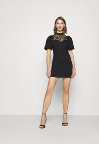 Glamorous - INSERT MINI DRESS WITH PUFF SHORT SLEEVES AND HIGH NECK - Vestido de cóctel - black - 1