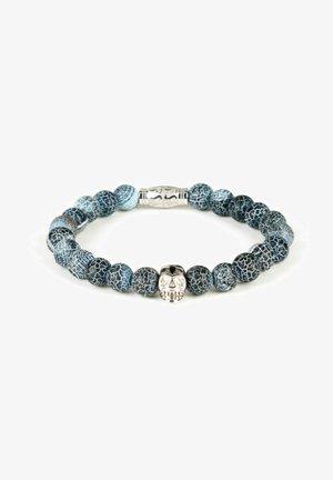 Rannekoru - kalksteen blauw