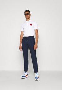 HUGO - DERESO - Polo shirt - white - 1