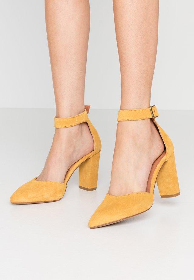 Lodičky na vysokém podpatku - milda mustard