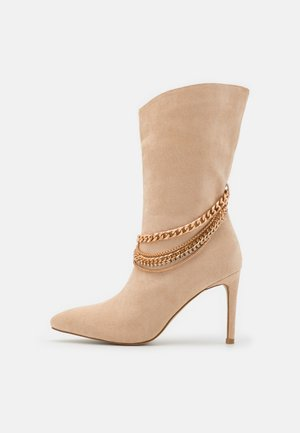 TRIXABEL - Classic ankle boots - nude