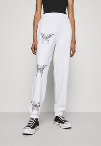 NEW girl ORDER - BUTTERFLY JOGGERS - Tracksuit bottoms - white - 0
