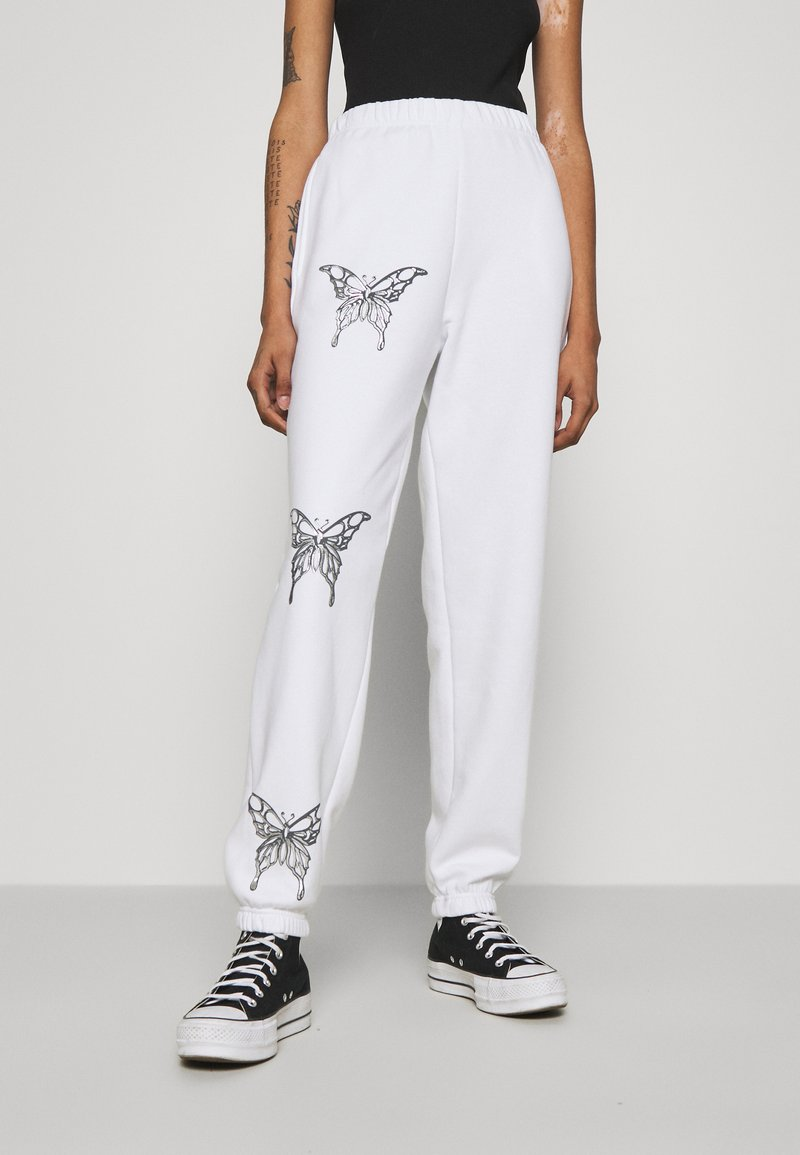 NEW girl ORDER - BUTTERFLY JOGGERS - Tracksuit bottoms - white