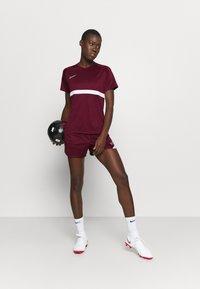Nike Performance - DRY - Print T-shirt - dark beetroot/white - 1