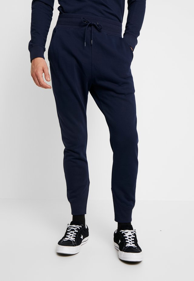 PREMIUM CORE TYPE - Tracksuit bottoms - sartho blue