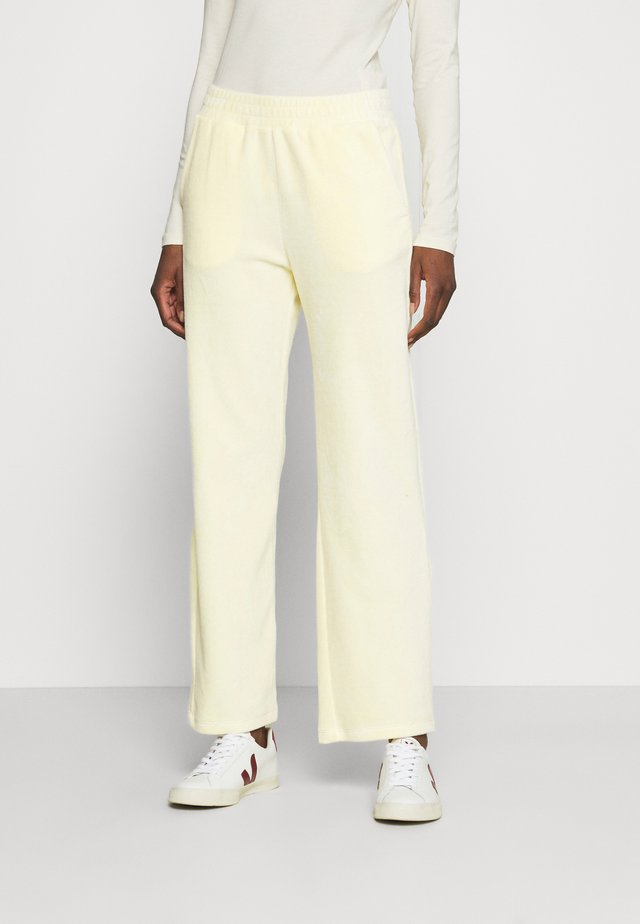 SWETA - Tracksuit bottoms - butter