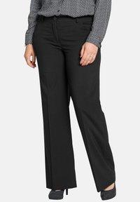 Sheego - Trousers - black - 0