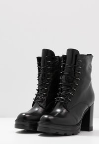 MJUS - Kotníková obuv na vysokém podpatku - nero - 4