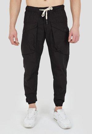 MIT AUFGESETZTEN TASCHEN - Cargo trousers - black