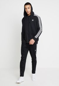 adidas Originals - STRIPES UNISEX - Huvtröja med dragkedja - black - 1