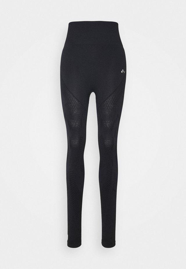 ONPJASE CIRCULAR - Leggings - black
