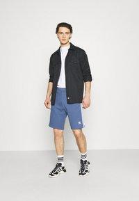 adidas Originals - 3 STRIPE UNISEX - Tracksuit bottoms - crew blue - 1