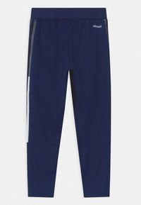 adidas Performance - TIRO UNISEX - Tracksuit bottoms - team navy blue - 1