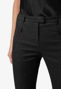 BOSS - ANAITA - Trousers - black - 2