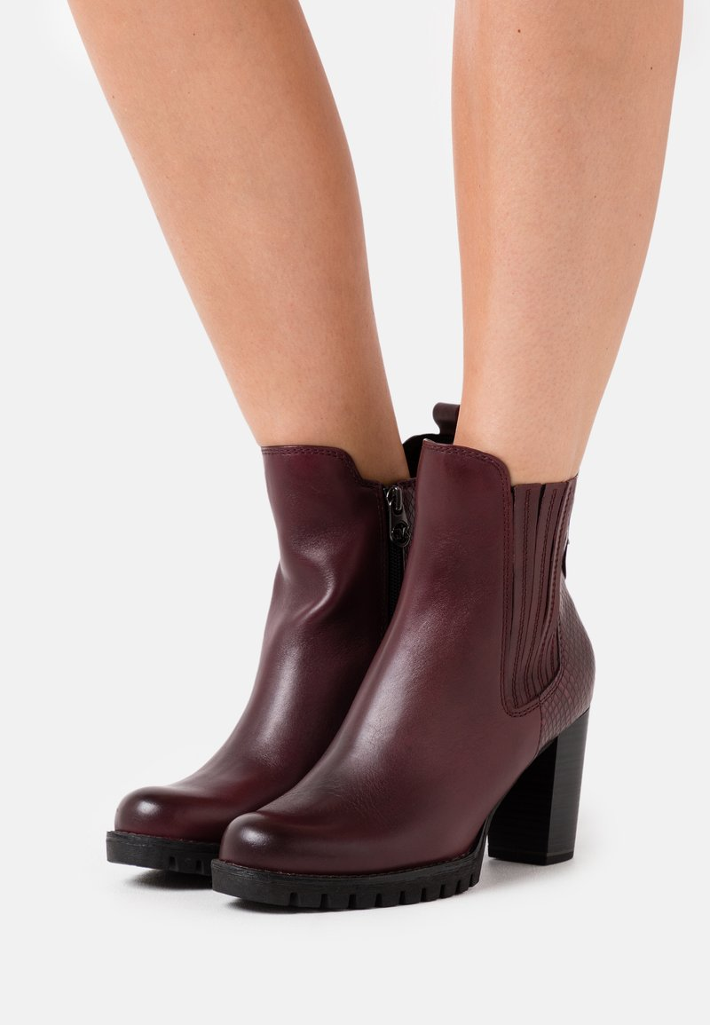 Marco Tozzi by Guido Maria Kretschmer - BOOTS - High heeled ankle boots - bordeaux