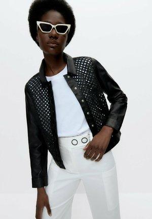MIT FLECHTMUSTER  - Leather jacket - black