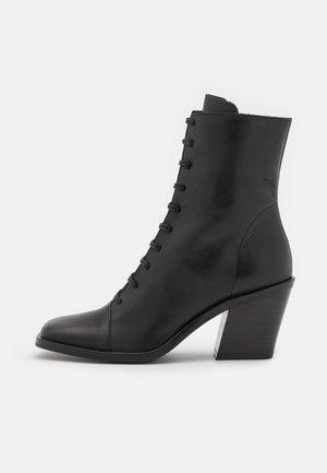 DEDANI - Šněrovací kotníkové boty - noir