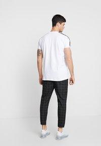 Kings Will Dream - ELGO - Trousers - black/white - 2