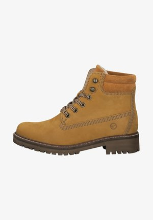 STIEFELETTE - Platform ankle boots - mango