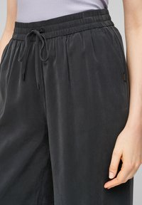 QS by s.Oliver - LOOSE FIT - Trousers - black - 4